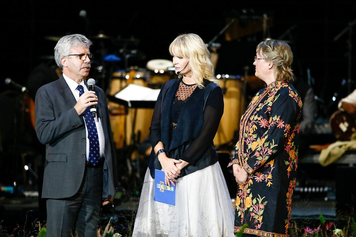 Michel Roy from Caritas Internationalis, the arena host, and Maria Immonen from LWF's World Service at the signing of the declaration at Together in Hope. Photo: Mikael Ringlander/Church of Sweden