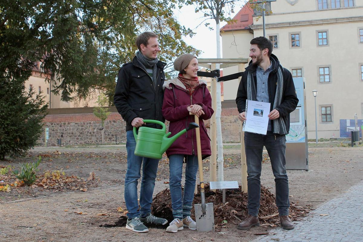 (From left) Sebastian Bugs, Sophie Bimmermann and Lasse Schmidt-Klie, members of the GNC/LWF Youth Committee planted the final tree in Wittenberg's Luthergarten on Reformation Day. Photo: GNC/LWF / Florian Hübner