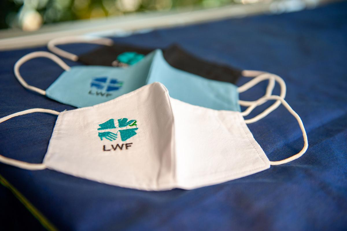 Wear it, share it. LWF embroidered protective face masks. Photo: LWF/S. Gallay