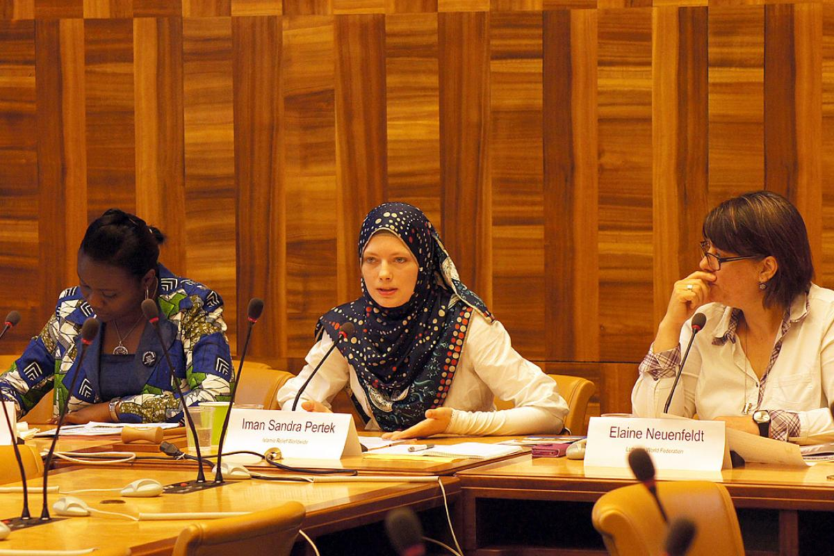 Olga Tshiwewe (WCC), Iman Sandra Pertek (IRW) and Dr Elaine Neuenfeldt (LWF, from left) discuss during the side event on violence against women at the Human Rights Council. Photo: LWF/C.Kästner