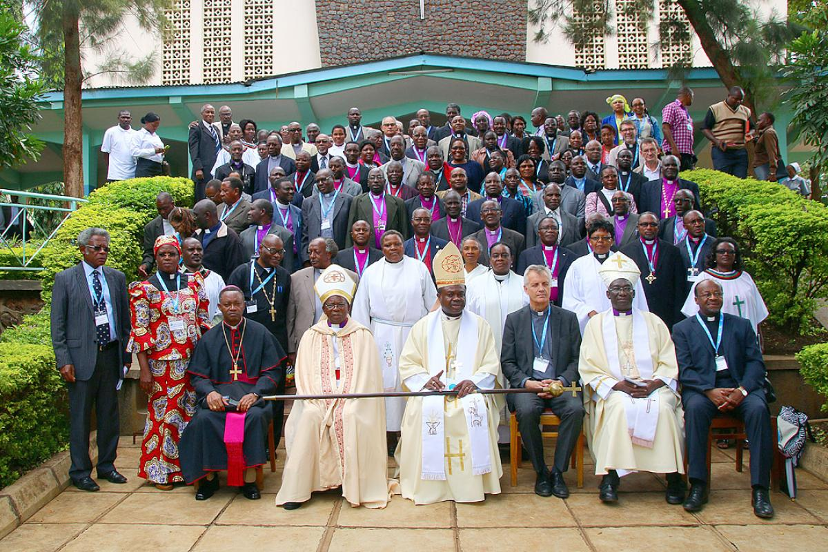Tanzanian and global Lutheran church leaders gather with other heads of churches in Africa outside the Moshi Town Cathedral. Photo: LWF/Allison Westerhoff
