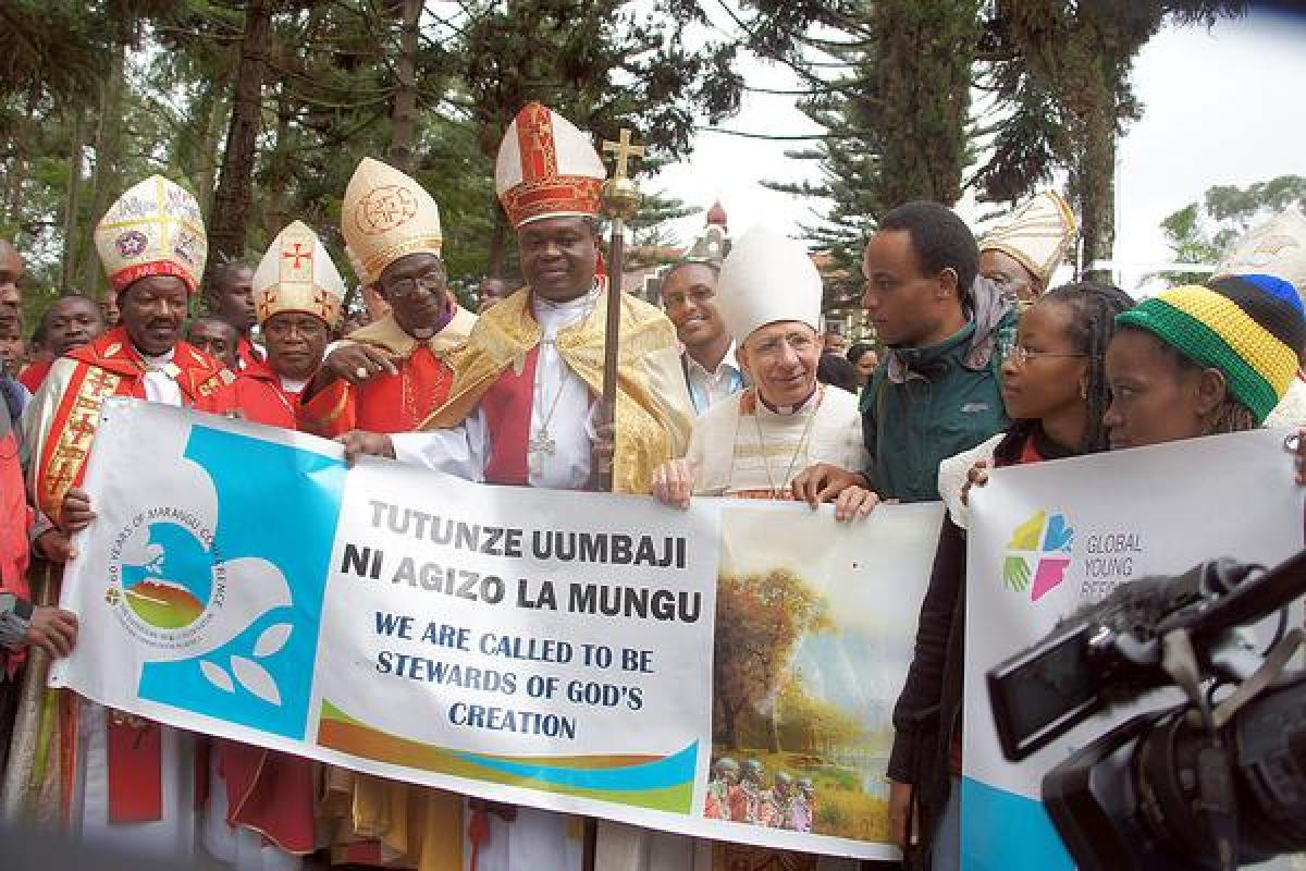 Bishop Younan (fourth from right) stands among Lutheran leaders welcoming a group of young Lutherans who climbed Mt Kilimanjaro. He told worshippers at the close of the Marangu conference that the challenge for Lutherans was to empower African Christians to more fully contextualize the gospel. Photo: LWF/Tsion Alemayehu