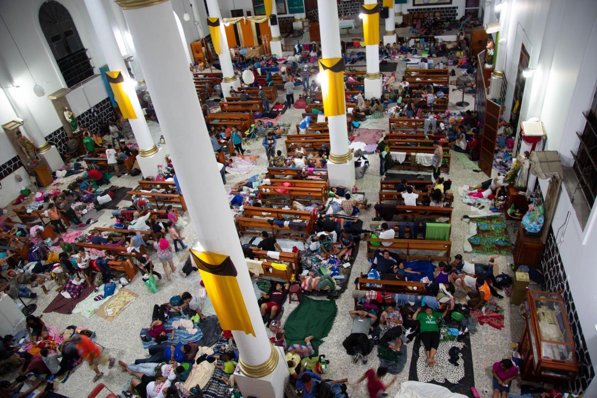 Migrants sleep in the pews at San Francisco Church in Huixtla, Chiapas, Mexico. Photo: LWF/ Sean Hawkey