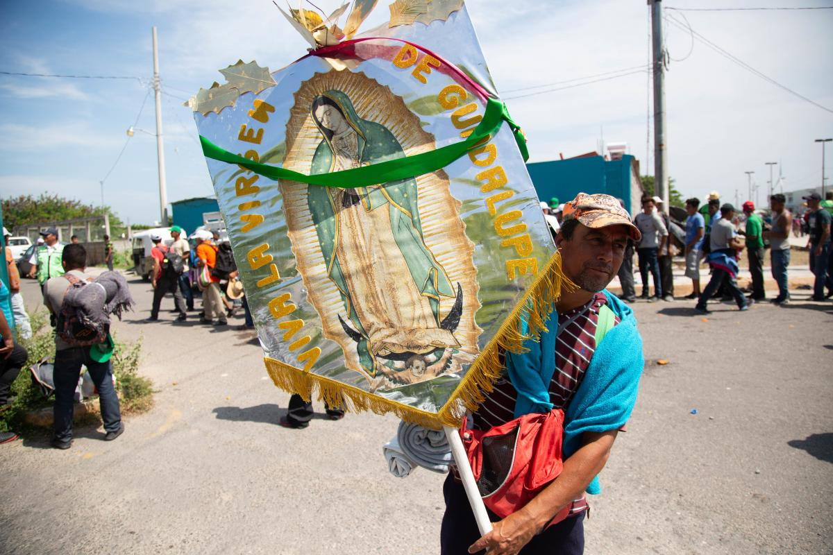 Walking under the protection of the Virgin of Guadalupe, Juchit·n, Oaxaca. This man carried her image, almost as if it were a religious procession, all the way from the border with Guatemala. Photo: LWF/ Sean Hawkey