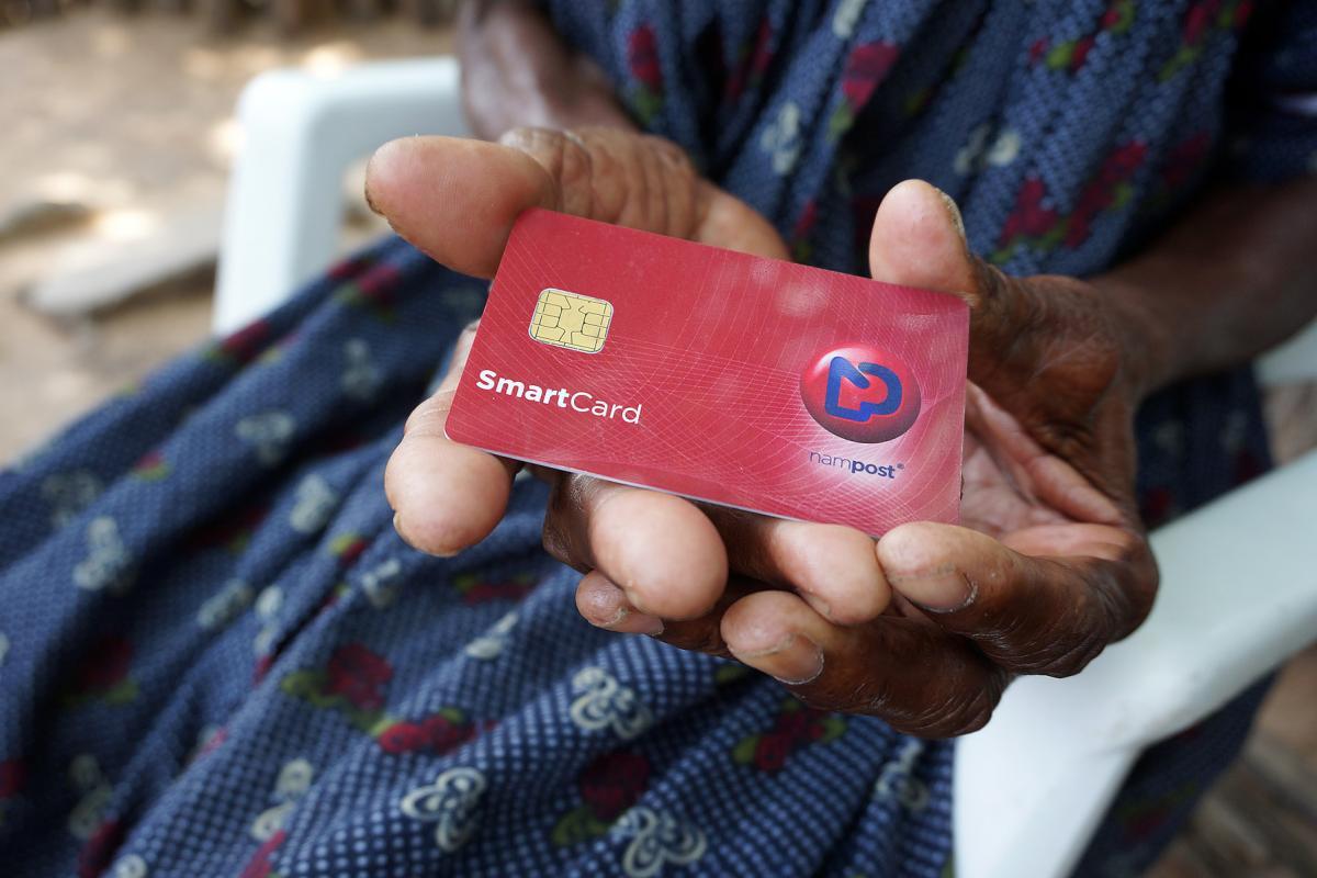 Ndapanda Mentte Shandingi shows a Nampost debit card. Photo: LWF/M. Hyden
