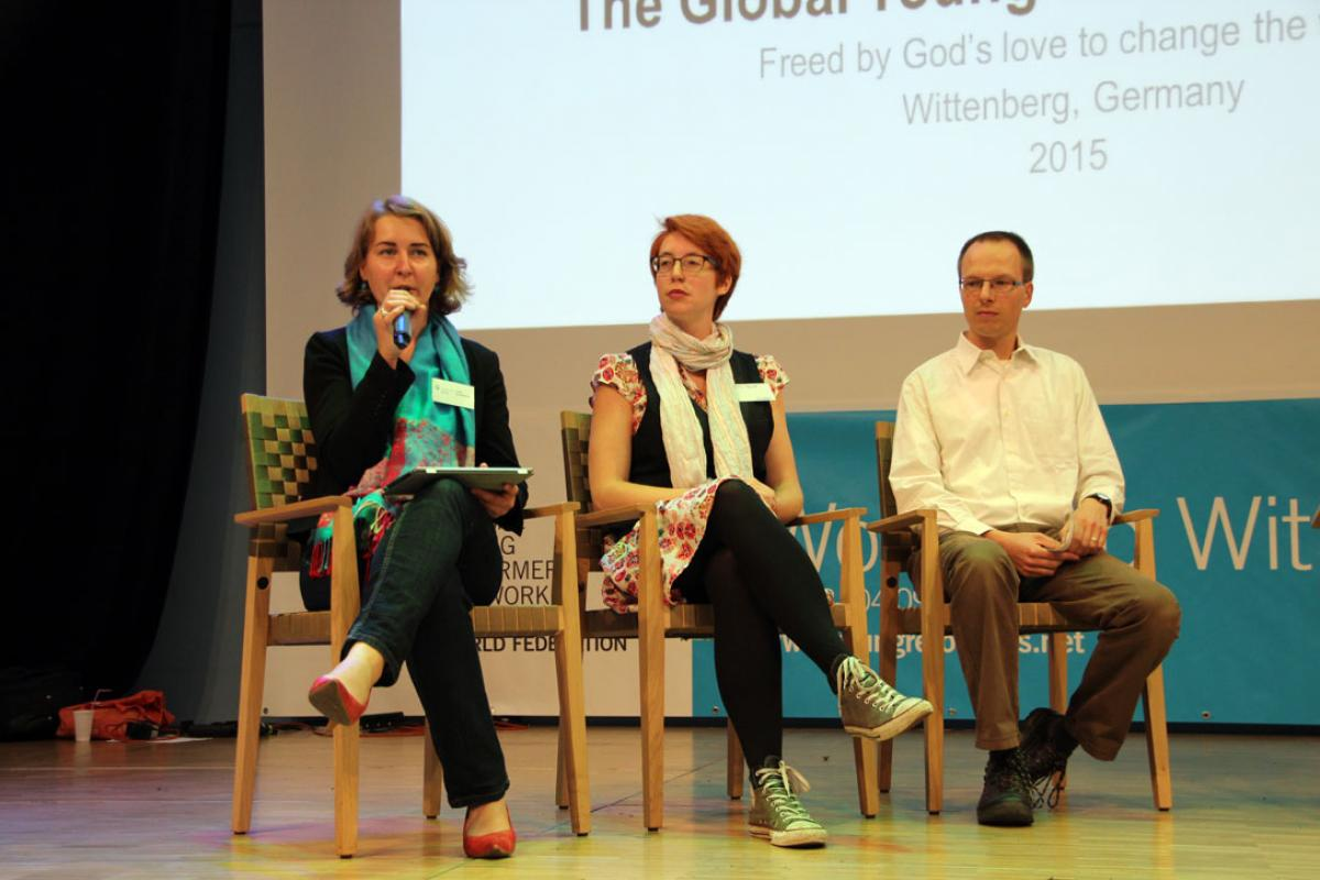 Cap: The panel comprising Judith Königsdörfer (WCC), Erin Clark (Church of England), Frère Jasper (Taizé) discuss the necessity of ecumenism, at the global gathering of young Lutherans, Workshop Wittenberg. Photo: DNK/LWB/F. Hübner