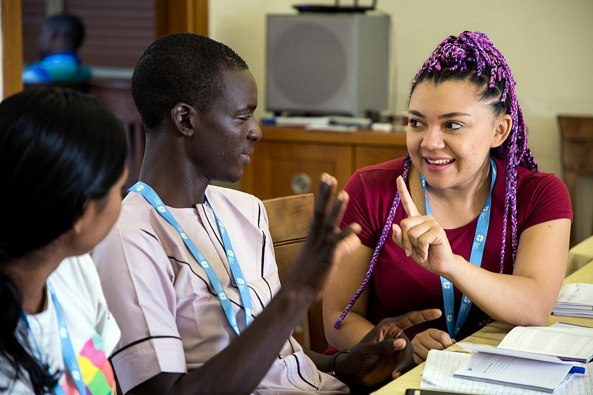 Group discussion during the training among Hanna Wright-Osborn (left) of the Evangelical Lutheran Church in America,  Levi Joniel (centre) of The Lutheran Church of Christ in Nigeria and  Angelica Oquendo (right) of the Evangelical Lutheran Church of Colombia. Photo: LWF/Ben Gray