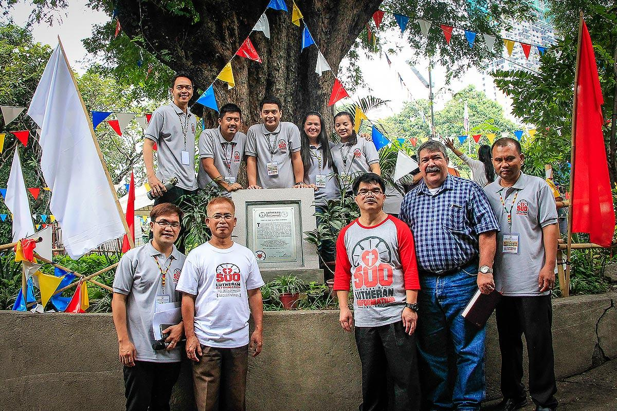 LCP President Rev. Antonio D. Reyes (second right) joins officials of the Philippine Lutheran Youth League and the young reformers at the commemorative plaque renaming the century-old tamarind tree as the LCP Tree. Photo: Ely Hernandez