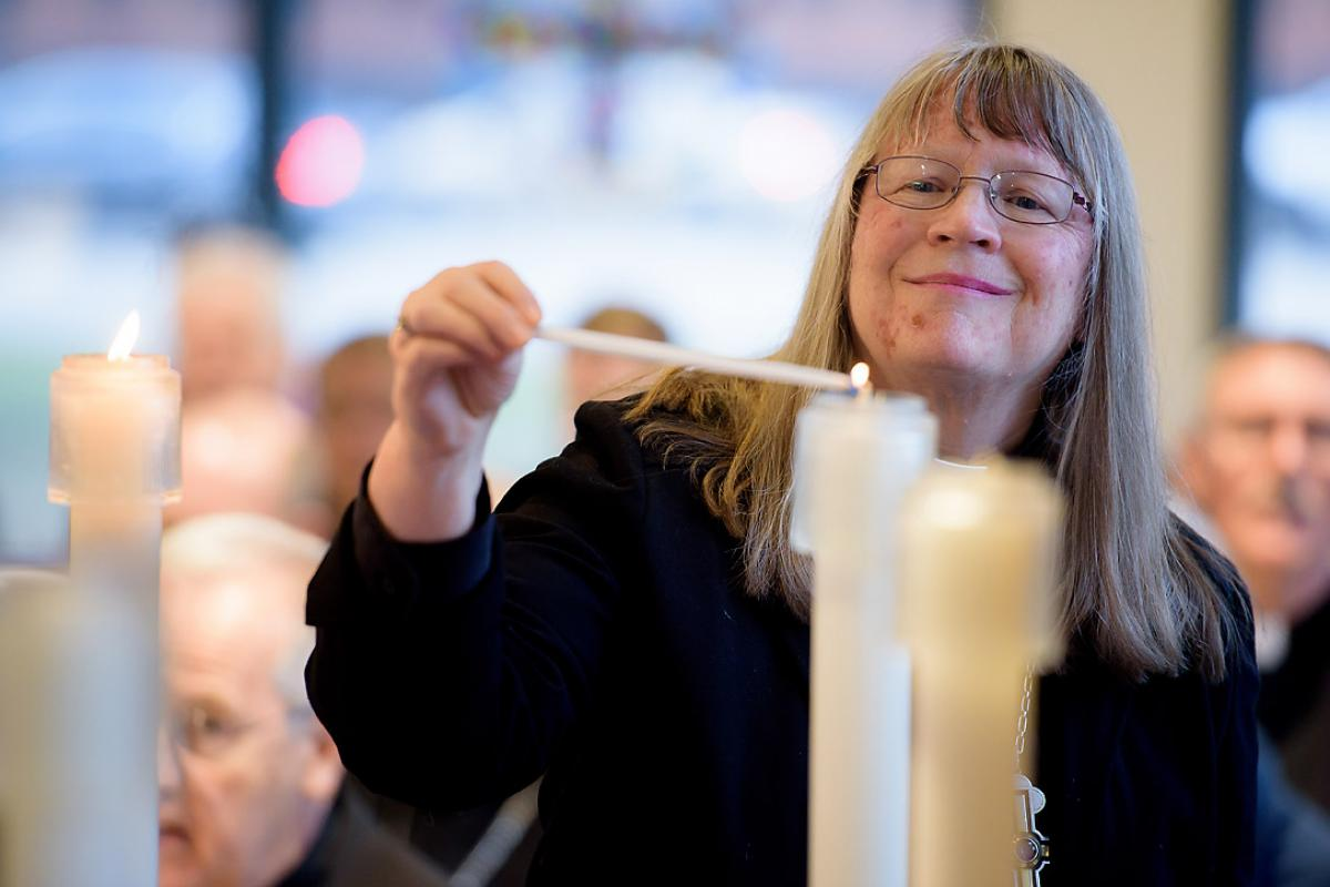 Rev. Jessica Crist, bishop of the Montana Synod of the Evangelical Lutheran Church in America, lights one of the candles for the ecumenical imperatives. Photo: C. Jason Brown/Insight Images