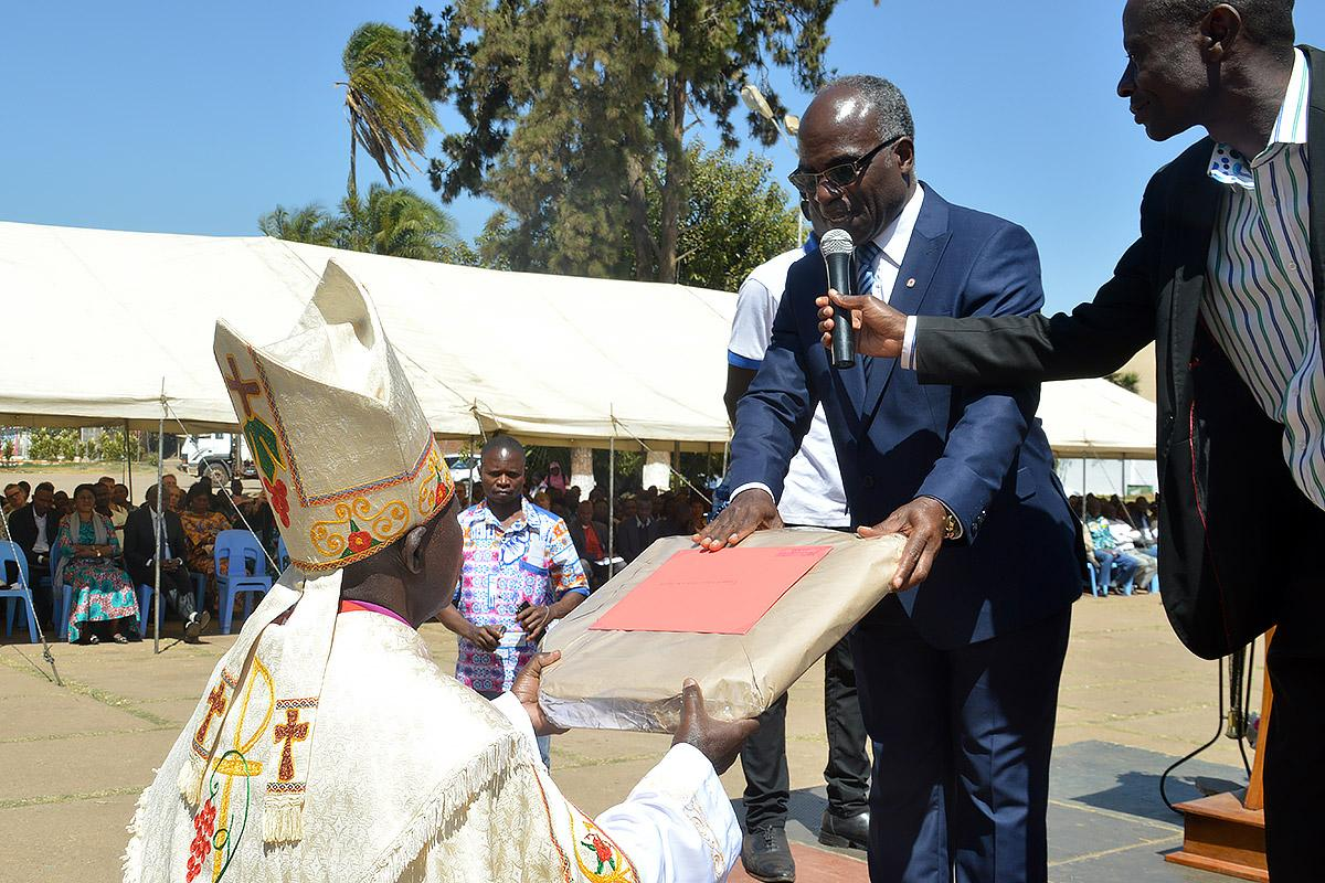 Evangelical Lutheran Church in Tanzania General Secretary Brighton Killewa, second from right, presents a gift to ELCCo presiding bishop Rene Mwamba Sumaili