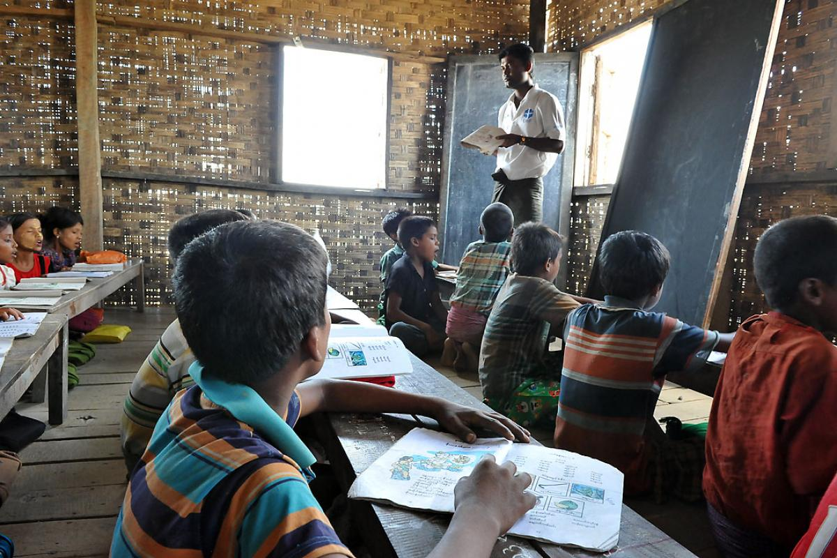 Children in one of the Nget Chaung-2 school rooms. These temporary classrooms constructed by LWF are the only school they are currently able to attend. Photo: LWF/ C. Kästner