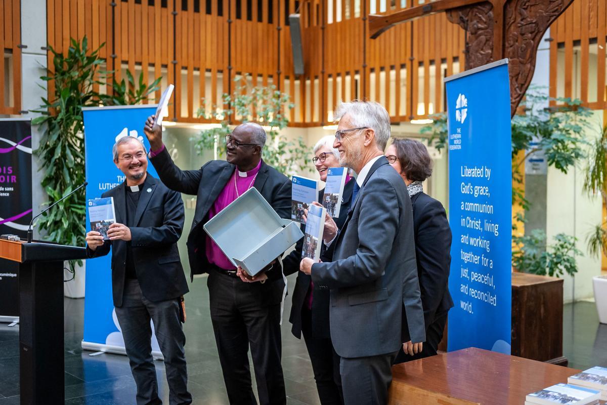 Unveiling the book. Left to right: Rev. Dr Sivin Kit, Archbishop Dr Panti Filibus Musa, Archbishop Dr Antje Jackelén, Rev. Dr Martin Junge, and Rev. Dr Simone Sinn. Photo: LWF