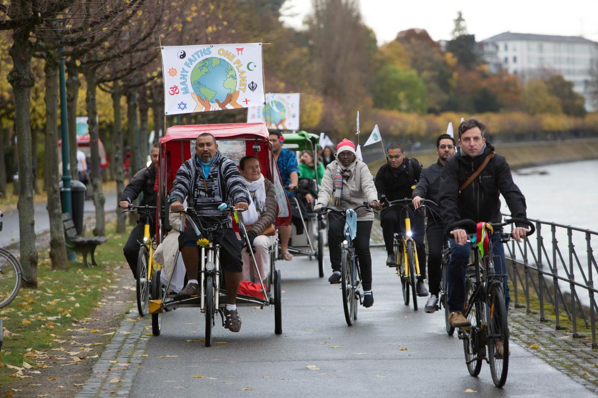 Joint engagement for justice: Interfaith bicycle demonstration at the climate conference in Bonn in 2017. Photo: Sean Hawkey/WCC