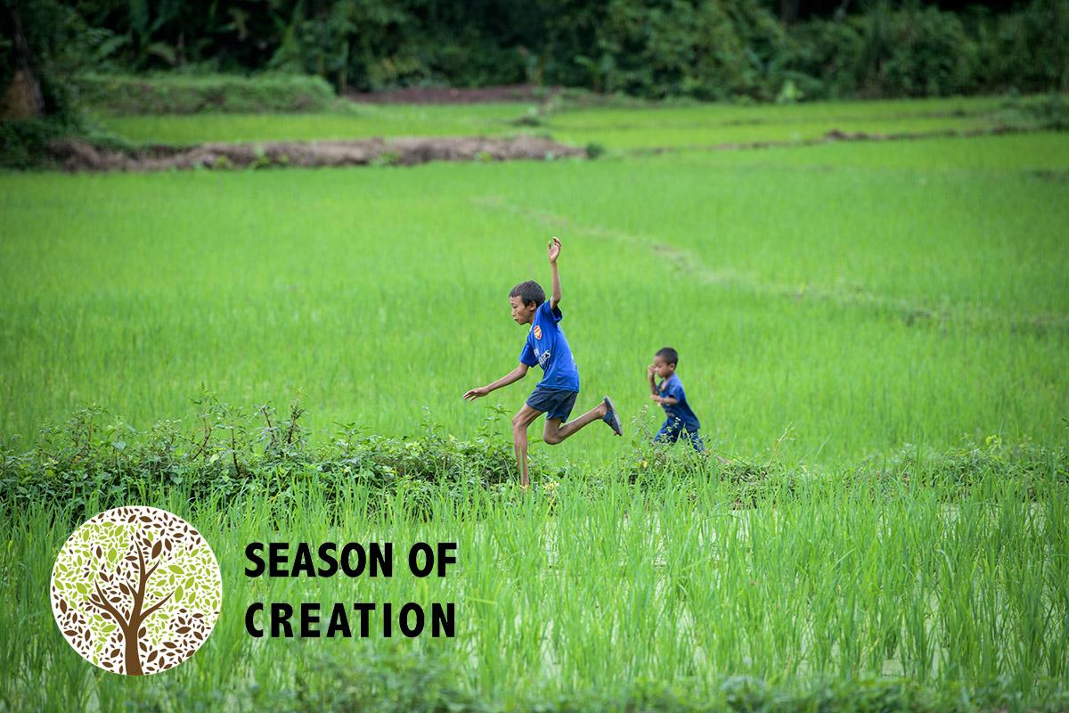 Children play in a rice field in Laos. Photo: LWF/Thomas Lohnes