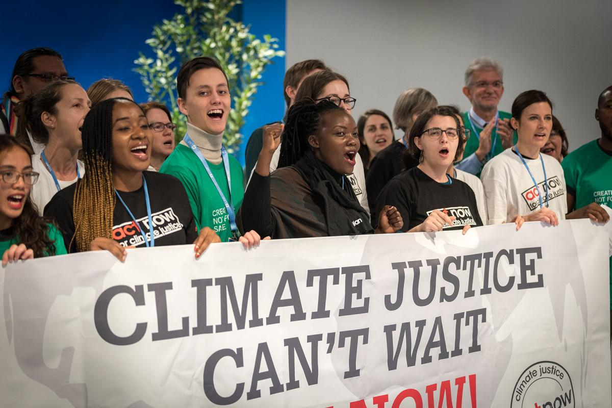 Young climate activists gathered in December 2019 at the COP25 summit in Madrid, Spain sound the alarm for climate justice. Photo: LWF/Albin Hillert