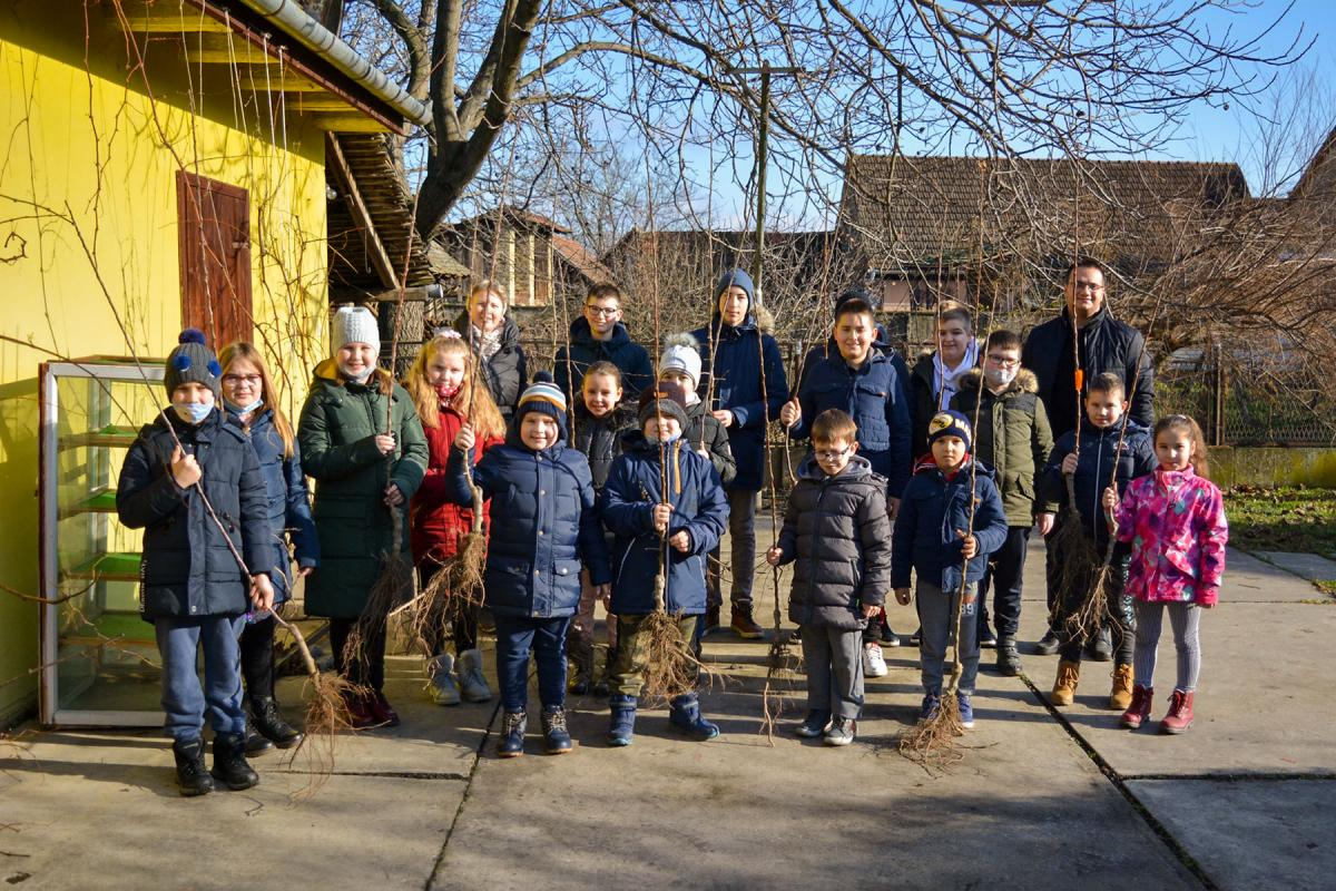 Pastor Miroslav Ponjičan (back right) with youth and children, preparing for a tree planting activity in the Slovak Evangelical Church of the Augsburg Confession in Serbia (SEAVC). Photos: SEAVC