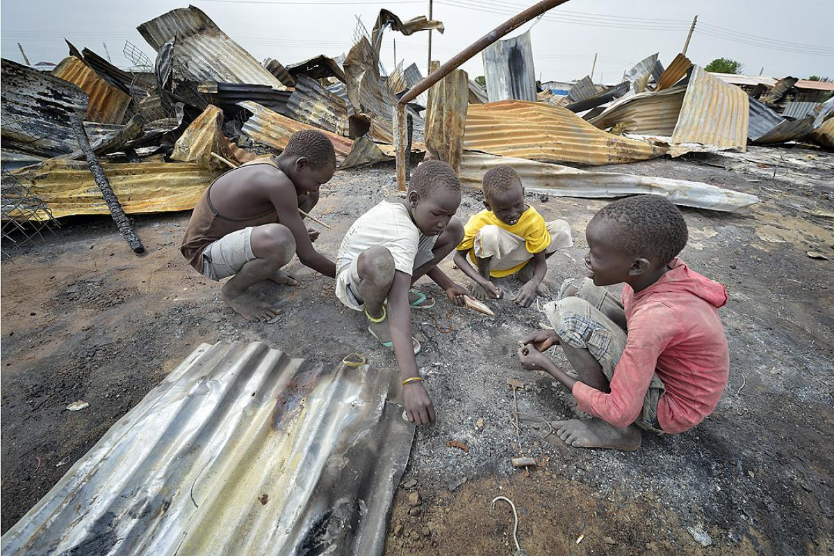 Children look for valuable items in the ashes of what was once the central market in Bor. Photo: Paul Jeffrey/ACT Alliance