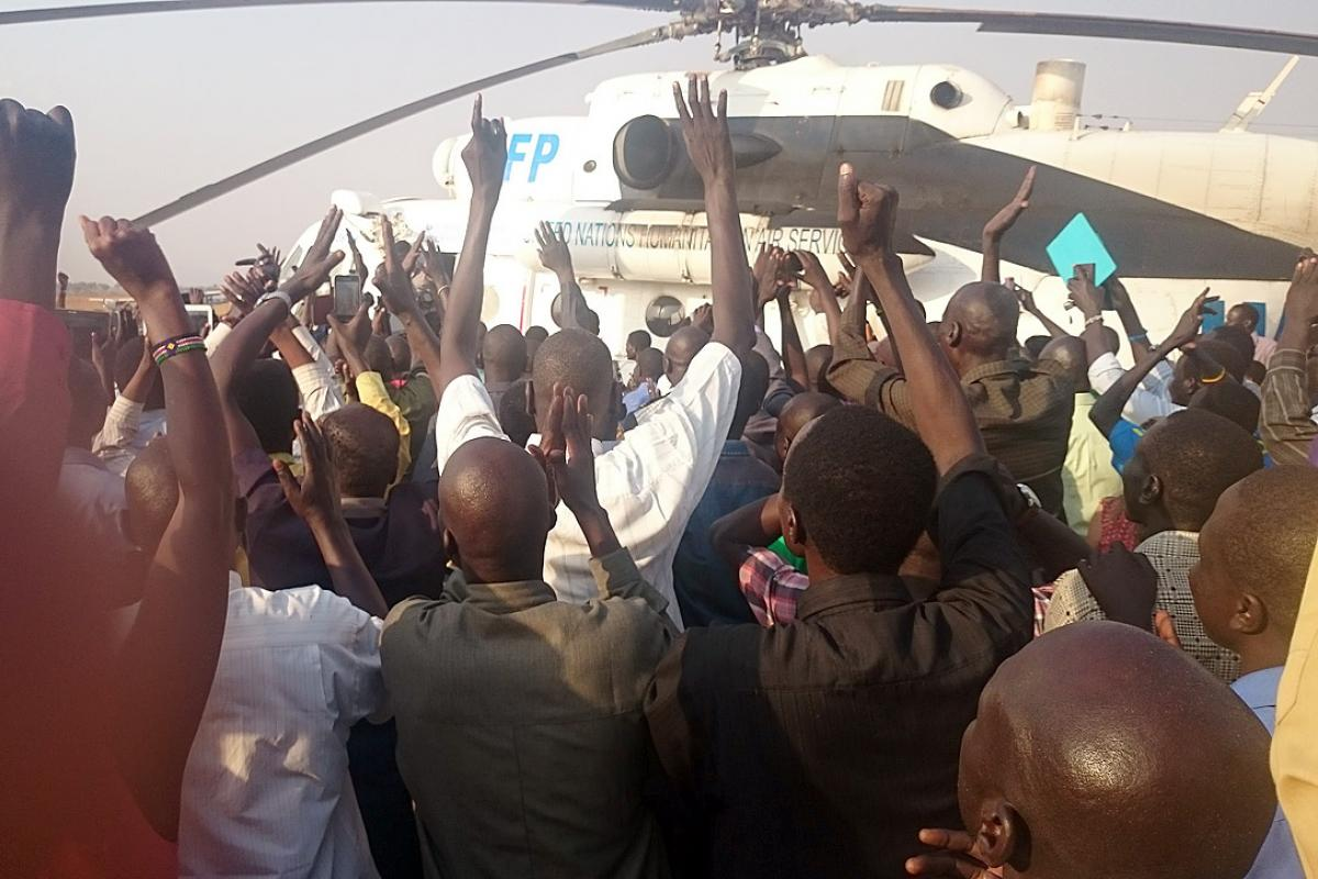 The returning LWF staff were welcomed by a crowd at Juba airport. Photo: LWF/E. Mpanya
