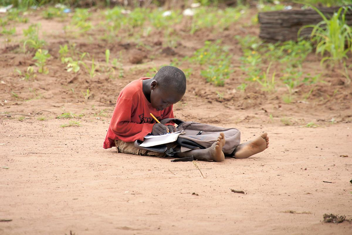 A young boy doing his homework in Yida refugee camp, South Sudan. Photo: LWF/ M. Hyden