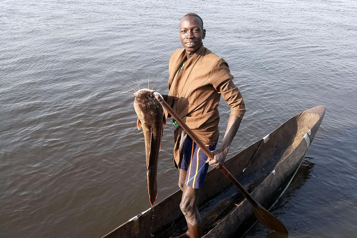 Fisherman Kur Kuany in his boat. Photo: LWF South Sudan