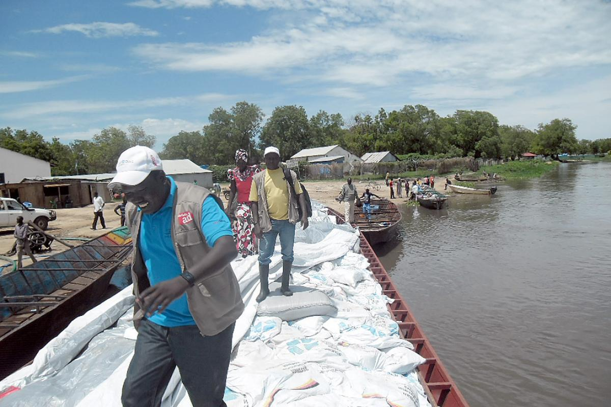 NFIs from the LWF and partner organizations are ferried by boat to remote islands in Twic East County, South Sudan.  Photo: LWF South Sudan/George Taban