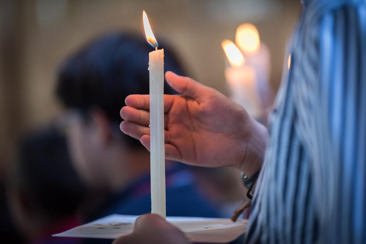 Candle lighting during a church service. Photo: LWF/Albin Hillert