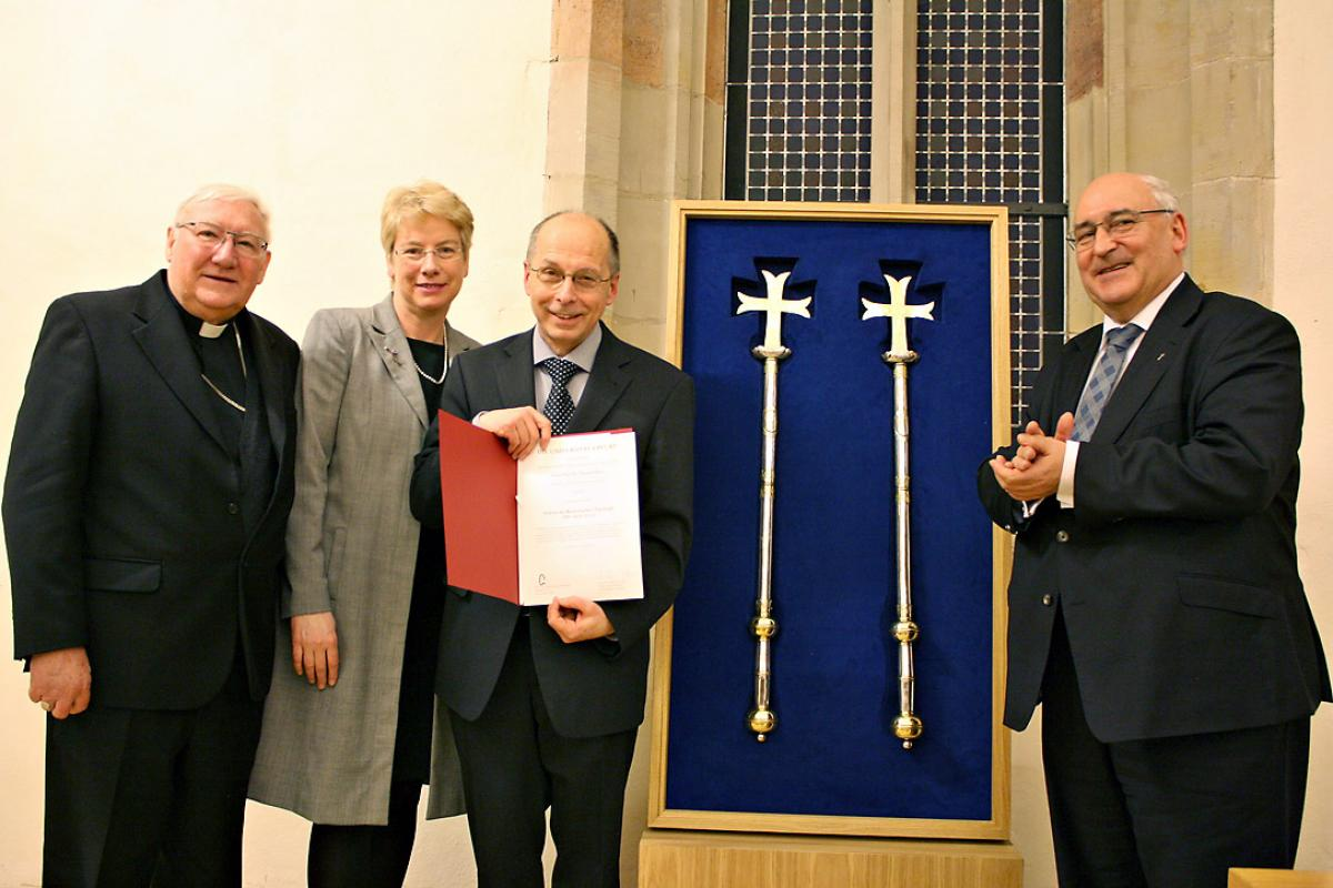 Well-wishers and honorary doctor: (from left) Bishop Brian Farrell, secretary of the PCPCU; Prof. Dr Myriam Wijlens from Erfurt University, Prof. Dr Theodor Dieter with his award and Prof. Dr Michael Gabel, dean of the Catholic Theology faculty at Erfurt University. Photo: Erfurt University