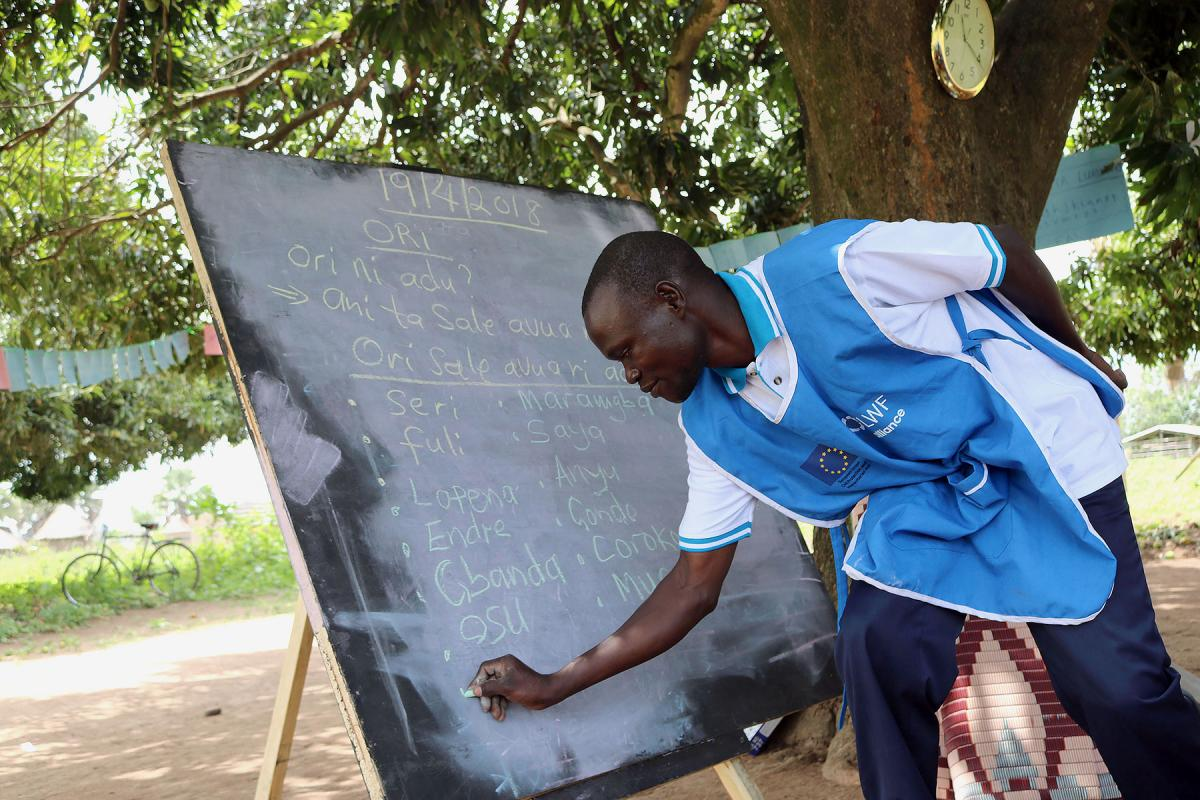 Paul Sunday Odriga teaches students at at Duba Functional Adult Learning Centre in Adjumani district.