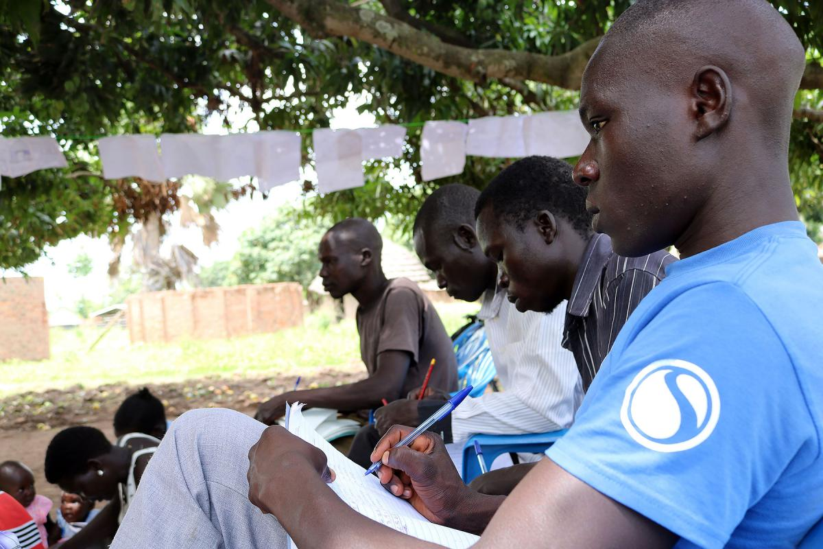 Men attend an adult literacy session at Duba Functional Adult Learning Centre in Adjumani district.