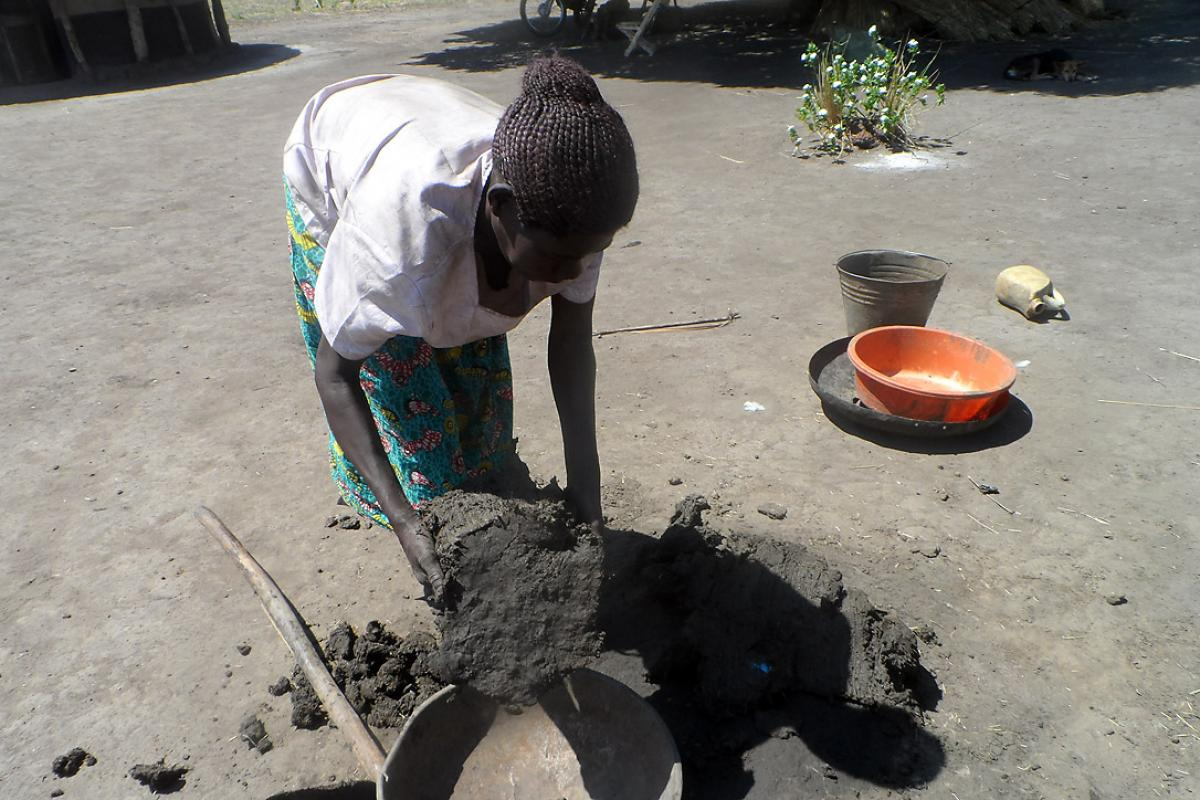 Margret Akot collects clay for the stoves. Photo: LWF Uganda