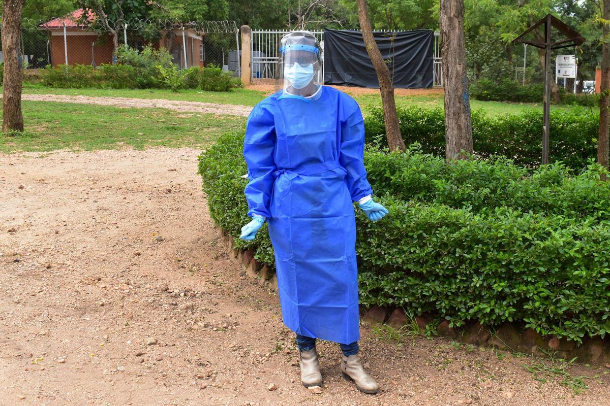 Josephine Nangonzi wearing full protective gear before starting work in the Palorinya refugee settlement in Uganda's West Nile region. Photos: LWF/Uganda