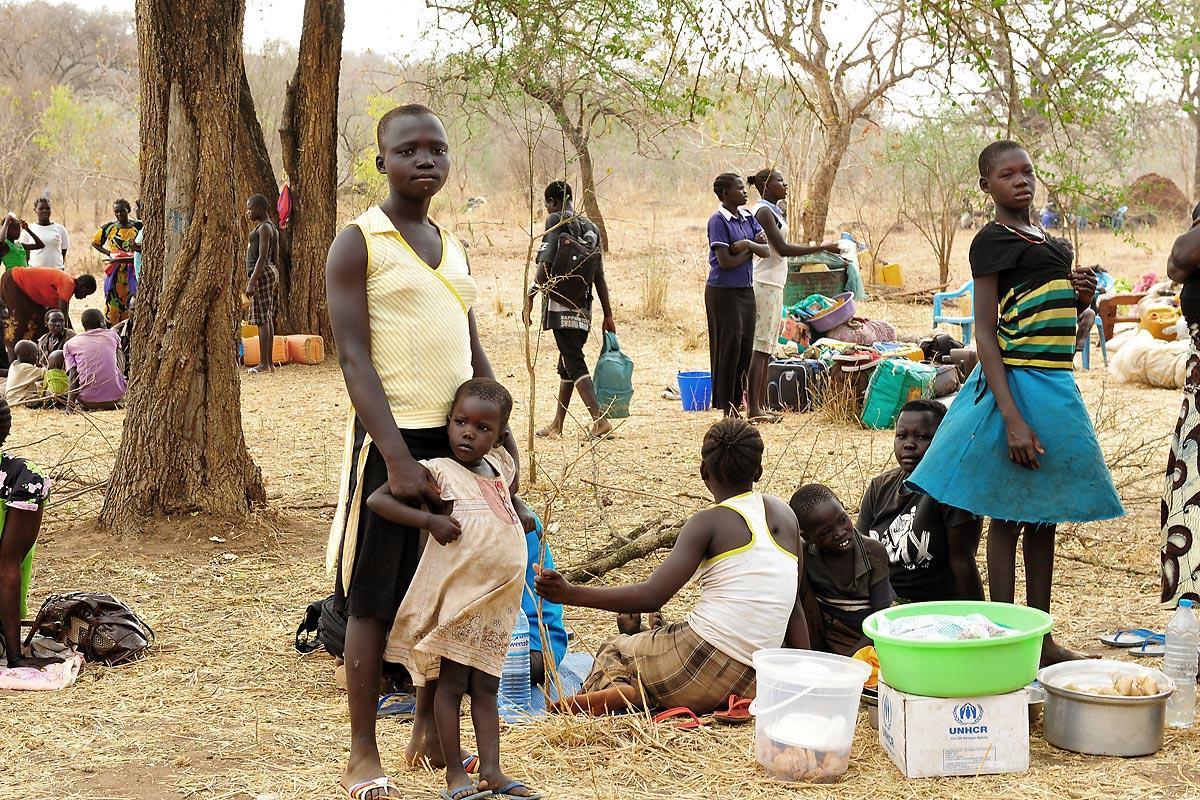 Refugees wait for land allocation in Palorinya refugee settlement, after walking for days. Photo: LWF/ C. Kästner