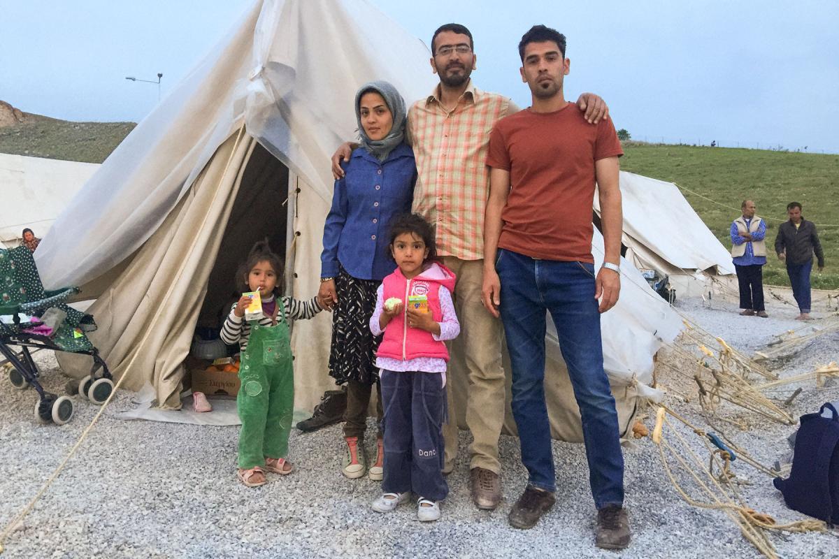 An Afghan refugee family in a Greek refugee camp, 2015. Photo: LWF/ J. Schreier