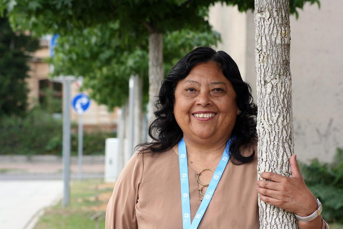 Rev. Adita Torres Lescano, Pastor President of the Lutheran Church of Peru, visiting the tree planted by representatives of her church in the Luthergarten in Wittenberg. This Reformation 2017 project symbolizes the ecumenical relationships of Christian churches worldwide through 500 trees creating a living memorial. Photo: LWF/A. Weyermüller