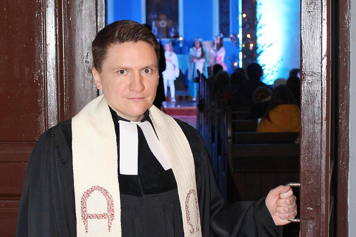 Pastor Vladimir Tatarnikov at the door of St. John's Lutheran Church in Grodno, Belarus. Photo: Oleg Shreders