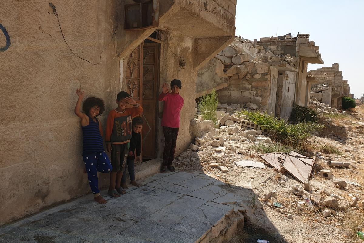 Children play in the destroyed suburbs in Aleppo. Photo: LWF/ R. Schlott