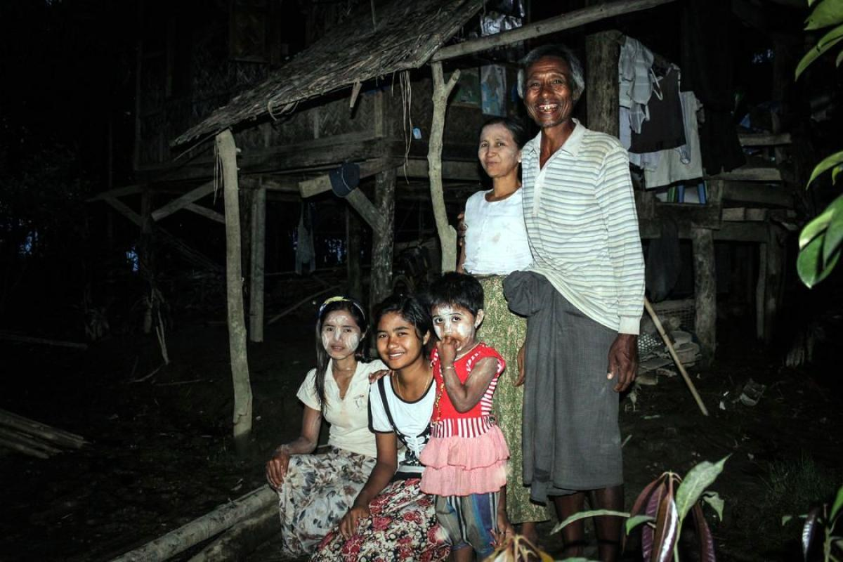 U Kyaw Thein and his family in front of their flood-affected home. Photo: LWF Myanmar/ M. Celiz