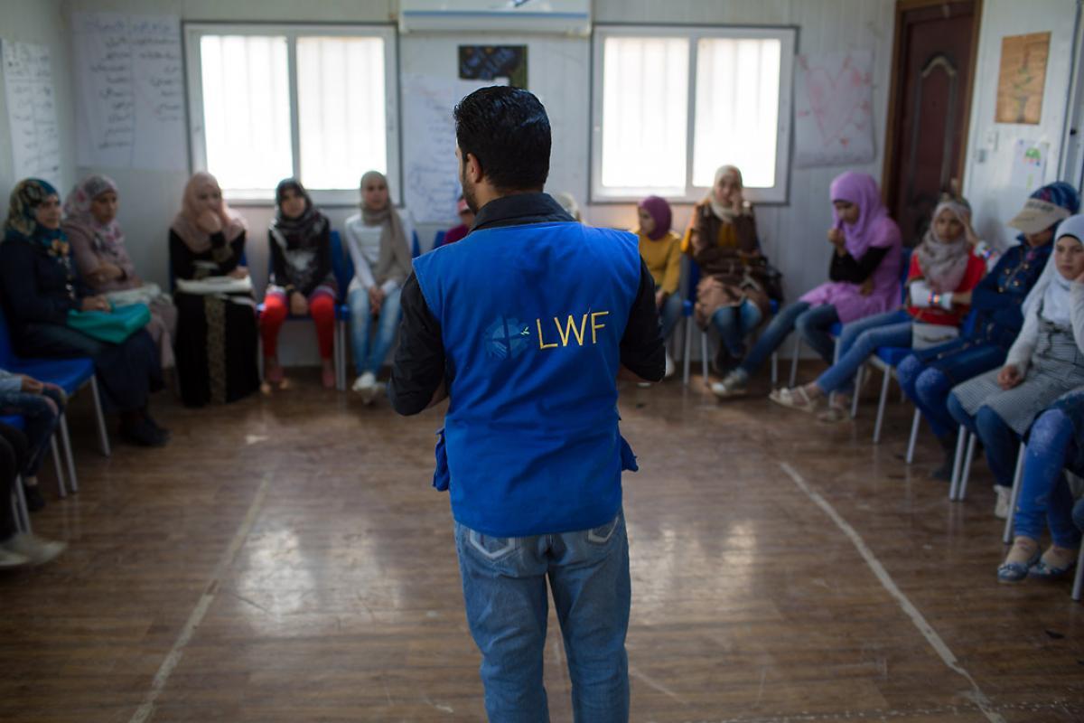 Syrian refugee Ahmad instills the value of education at the Za'atari camp. Photo: LWF Jordan