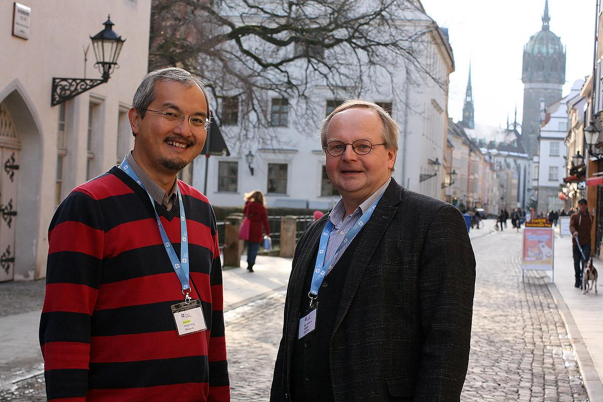 Prof. Dr Karl-Wilhelm Niebuhr, on the right and Rev. Dr Sivin Kit, at his left, lecturest at the 17th International Theological Seminar, taking place in Wittenberg, Germany. Photo: LWF