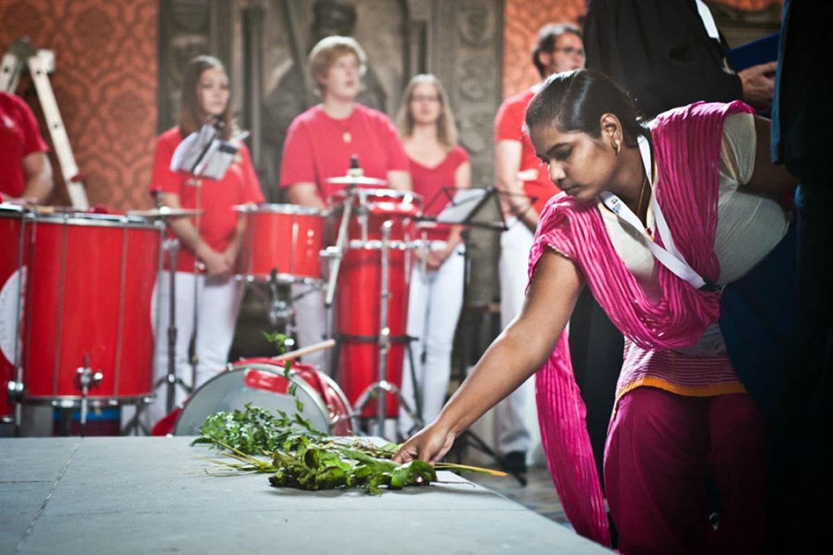 During opening worship in the Castle Church, young reformers were invited to bring to the altar symbolic gifts from their respective regions. Photo: LWF/Marko Schoeneberg