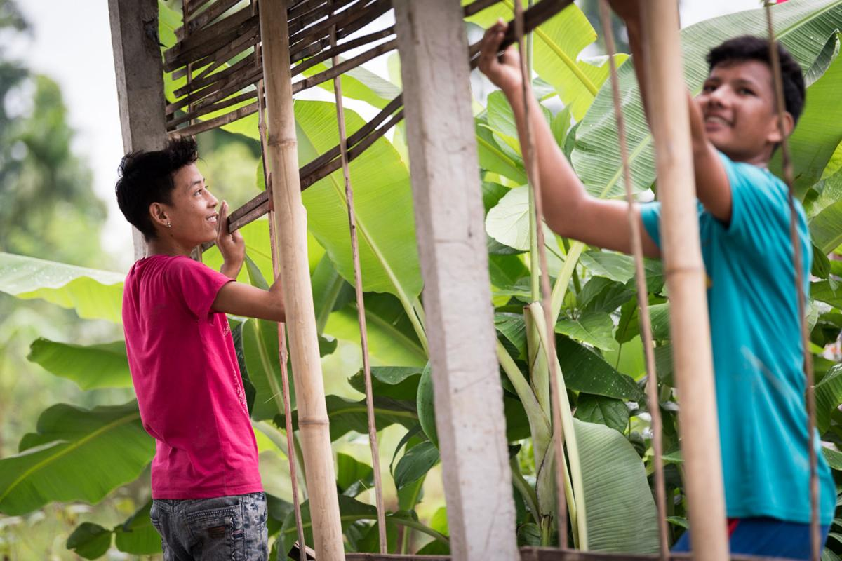 Two young men construct a house in the Beldangi Refugee Camp in southeast Nepal. Photo: LWF/Albin Hillert