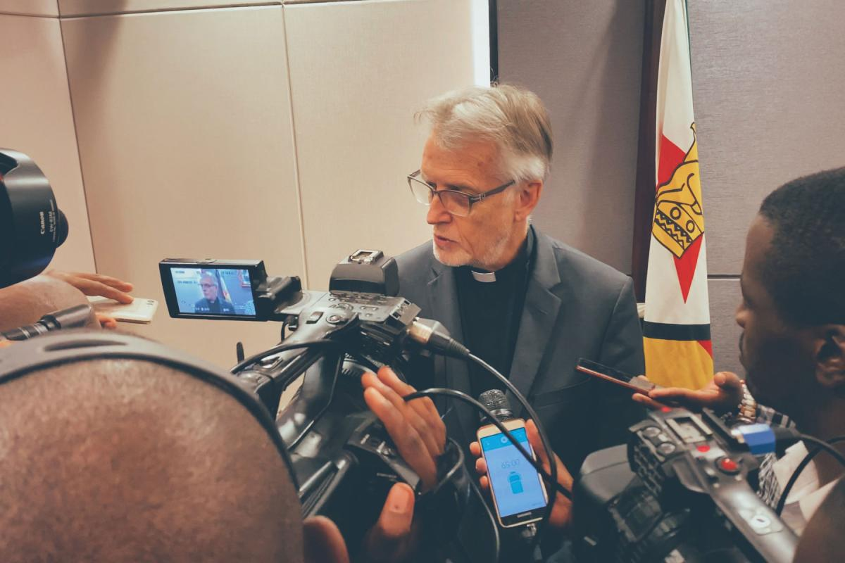Journalists interview LWF General Secretary Martin Junge following a meeting with government officials in Harare. Photo: LWF/A. Danielsson